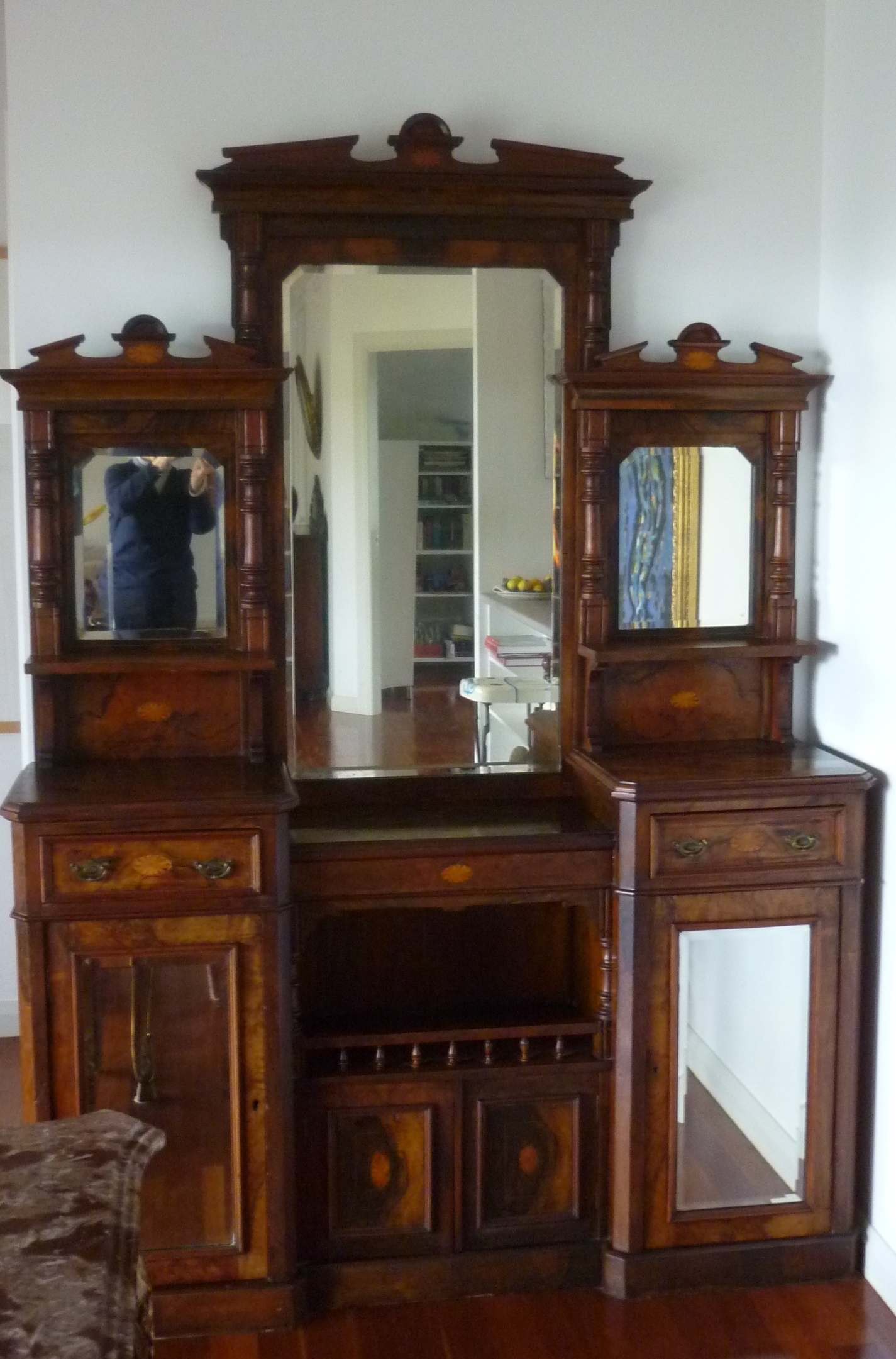 Attractive Rosewood veneer chiffonier with pattern inlay. Can be separated to two pieces for transport. Mirrored, two drawers, lower shelves. approx. 220cm tall. Some marks and damage to baseboard panel.