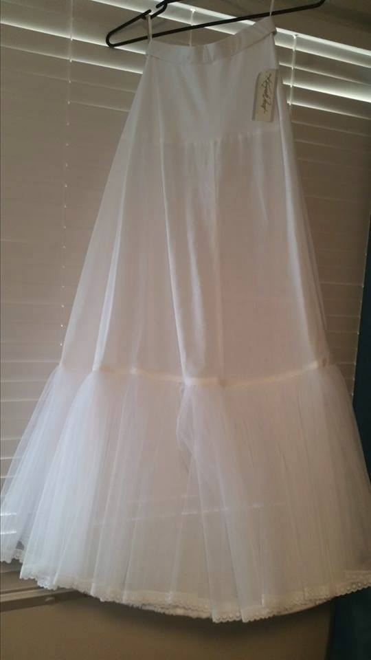Mia Solano, Aimee wedding gown.   I unfortunately was recommended to buy a size that I will have no hope of fitting into. Its never worn and been carefully stored in a breathable storage bag.  I will be including the veil and the hoop in the purchase.  It is located in ...