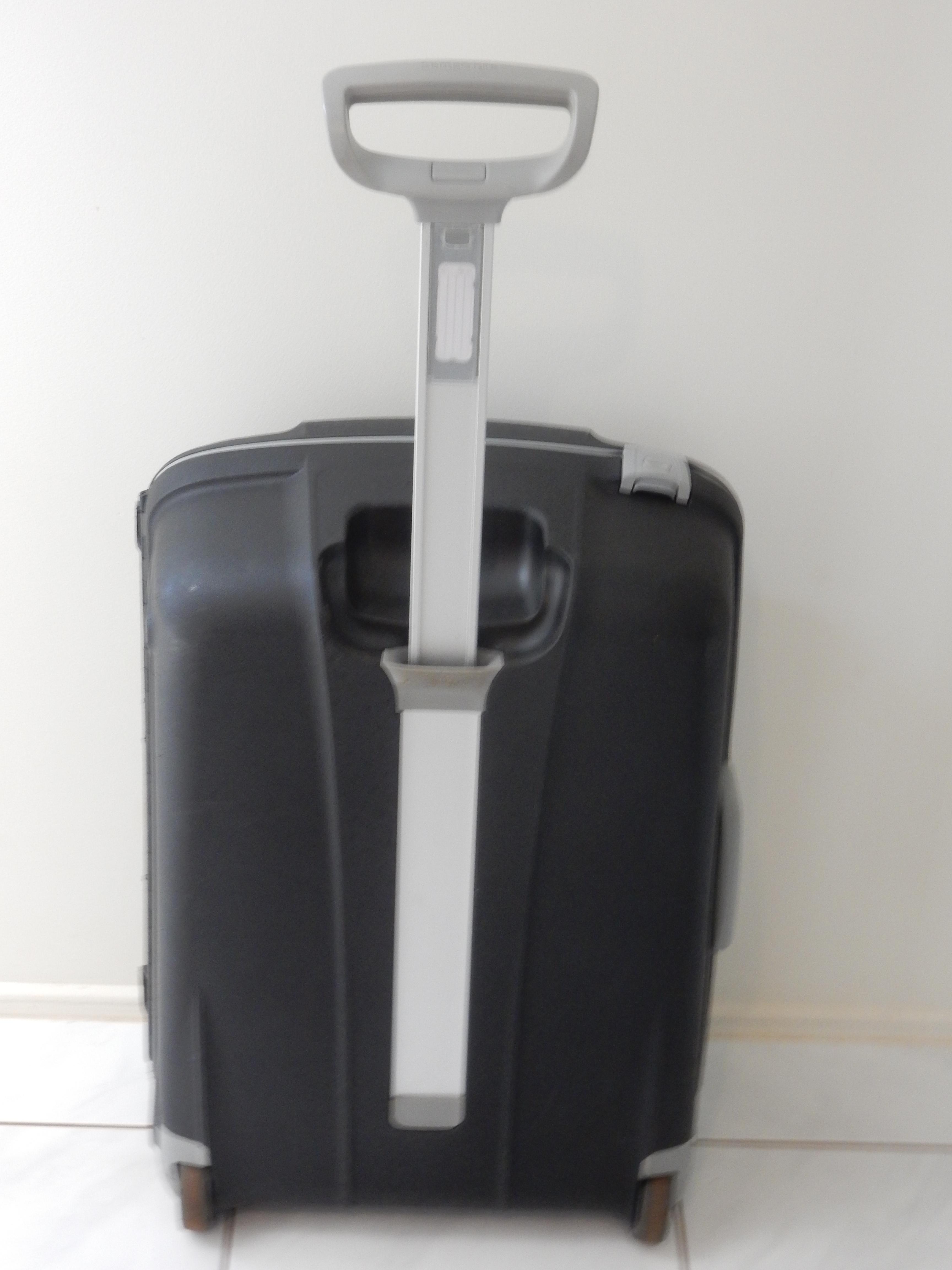 samsonite travel bag hard cover 2 wheeler grey black  87.5 litre number coded built in lock  8 years  global warranty