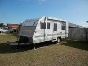 2002 REGAL     Full van  In excellent condition  double bed  full kitchen  fully serviced  cupboards galore  green shade cloth annexe  a/c  best in Qld  registered  $21,000 ono   Phone 0448 041 383