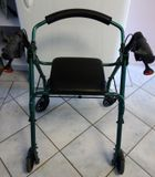 Good condition Walker Assist push trolley with seat.  Metallic green and black. Has no basket under seat...someone stole it! Hand brakes in good condition.