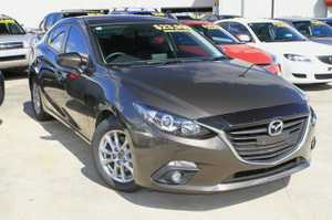 2015 Mazda 3 MAXX with just 12,627klms!  this automatic sedan looks great in Titanium Flash, and is well equipped with SAT NAV, Reverse Camera and Sensors, iStop Technology, Bluetooth Phone, and a Log Book Service History!  We are a family owned Award winning Multi-franchise Dealership which has been servicing ...