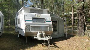 """2005 17'6"""" Poptop, Single Axle,   Full Annexe, Hi-Clearance,   Awning, 130L Fridge, Dbl Island Bed, A/C,   Gas Bottles, Battery Pack & extras.   VGC $21,000   Phone:"""