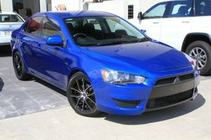"""A great looking CJ Lancer!  Our 2010 Lancer has been kept in great condition and looks brilliant in Blue with Aftermarket 17"""" Alloy Wheels, Dark Tinted Windows, and a Carbon rear Spoiler!  This Lancer has also been fitted with a Kenwood Head unit, with Bluetooth and Pandora Capabilities.  This great ..."""