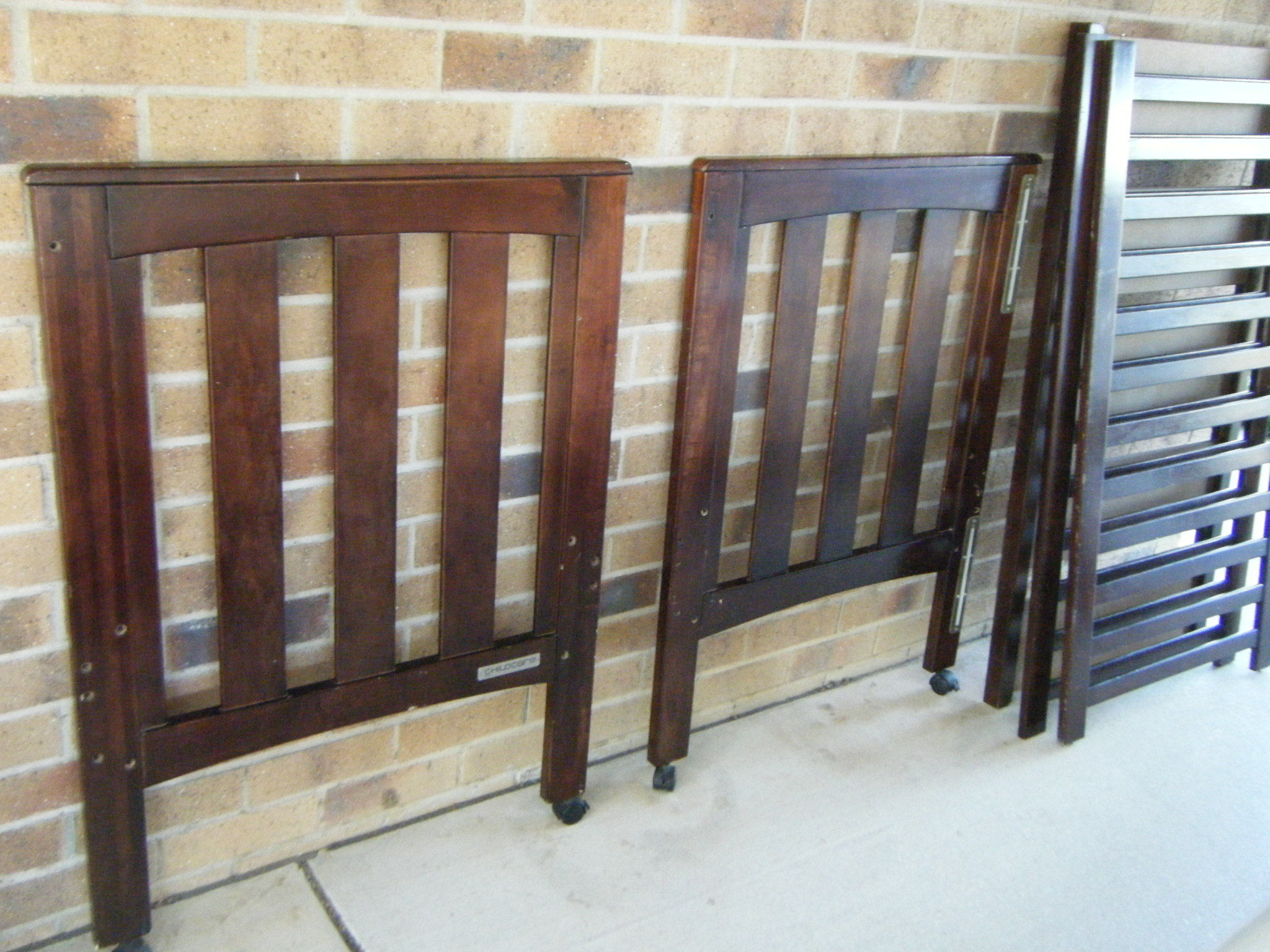 Dark stained timber cot.  Free mattress and teething rail.  $60.  Pick up Kingaroy