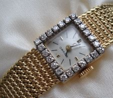 OMEGA  bracelet watch, 18ct. gold 24 Diamonds, recently overhauled very elegant/exquisite, limited 1962 edition cost $ 9750.00  sell $ 3200.00  ONO