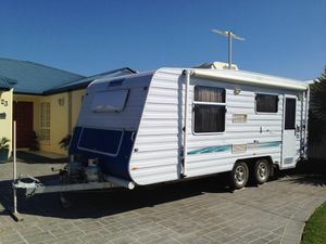 Excellent condition very little use Rego Feb 2016. Air conditioned , queen size bed, shower/toilet, 3way fridge, TV, microwave, gas stove, 12v/240v.  Full annex all equipment included.  New Honda 2kva generator & dual spare wheels