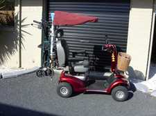 A Shoprider Scooter with a canopy and an attachment to hold your wheelie walker.  It is equipped with two 70 amp batteries to take you all over town.  Well cared for and enjoyed regular maintenance.