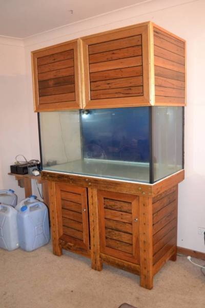 4x2x2 with custom hardwood cabinet. Everything you meed to keep fish and corals, inc. skimmer, pumps, lights, protein skimmer, auto topup, nutrient dosing pump etc etc.