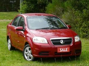 2011 Holden Barina TK MY11 Flame Red 5 Speed Manual Sedan