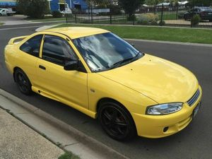 2003 Mitsubishi Lancer CE GLI Yellow 5 Speed Manual Coupe