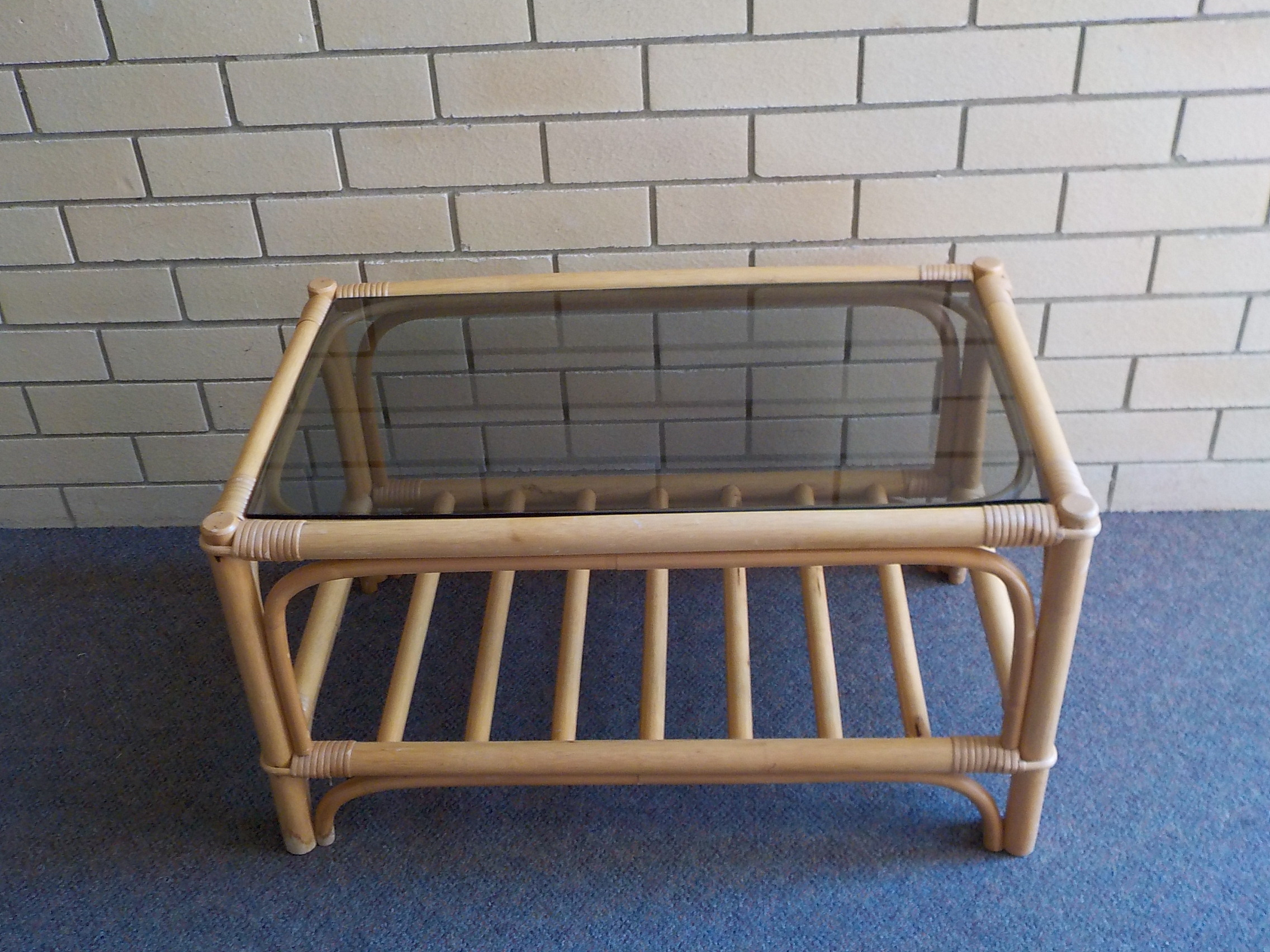 Coffee table glass top with cane frame 79w 50d 44h AS NEW  in excellent condition