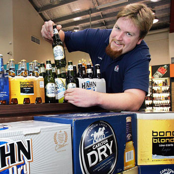 Luke Fortescue, of First Choice Liquor Maroochydore, toasts the range of low-carb beers and sparklings wines. Photo: Brett Wortman