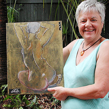 Guiliana De Witis shows off one of her works which will be on display at the Cooroy Butter Factory from this weekend.