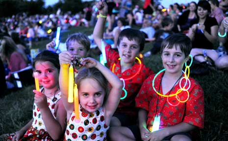A group of kids pictured at a past Carols by Candlelight at Lismore's Riverside Park.