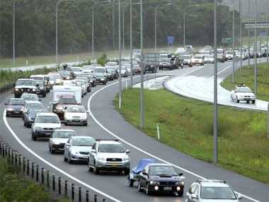 Traffic crawls on the East-West Sunshine Motorway as holiday makers head home after the Easter long weekend. Photo: Michaela O'Neill/182051