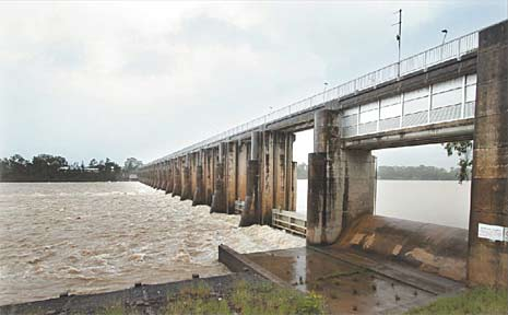 Computer-controlled gates at Rockhampton's barrage open automatically as the level in the storage rises. (File photo)