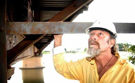Builder George Oxenbridge checks out the rust and spalling on Grafton Bridge.