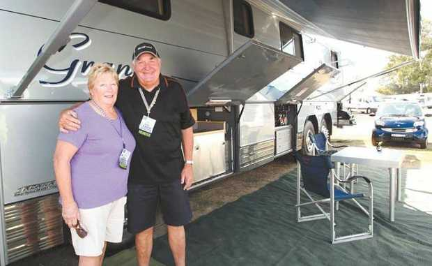 Aileen and Ron Penfold with their luxury motorhome away from home.