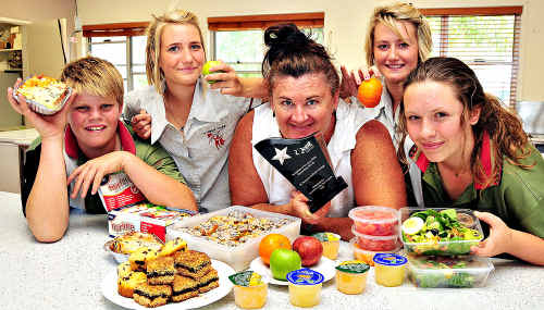 St Theresa's Catholic College tuckshop convenor Lorna O'Connell with students James Grigson, Kara Mackrell, Jaymi-Lee Castle and Anna Bennett.