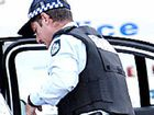 POLICE believe a shotgun has been used to blast a hole in a woman's garage door at a home in Bundall on the Gold Coast.