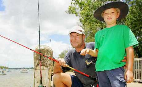 Young angler Daniel Cure, 6, gets a hand from Keith Reynolds to bait his hook and learn the rules of fishing at the Quay Street public wharf in Rockhampton. Daniel caught his first fish, a sooty grunter, which wasn't big enough to keep but was enough to keep Daniel interested in fishing a bit longer.