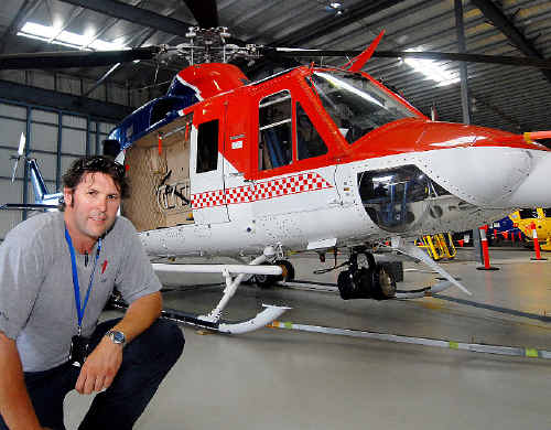 Pilot Michael Tweedie flew RACQ-CQ Rescue's new Bell 412 helicopter to Mackay from Orange yesterday.
