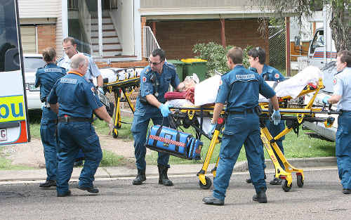 Paramedics attend to Milan Danny Susec. A court later determined that he stabbed himself to make his estranged wife's murder look like self-defence.