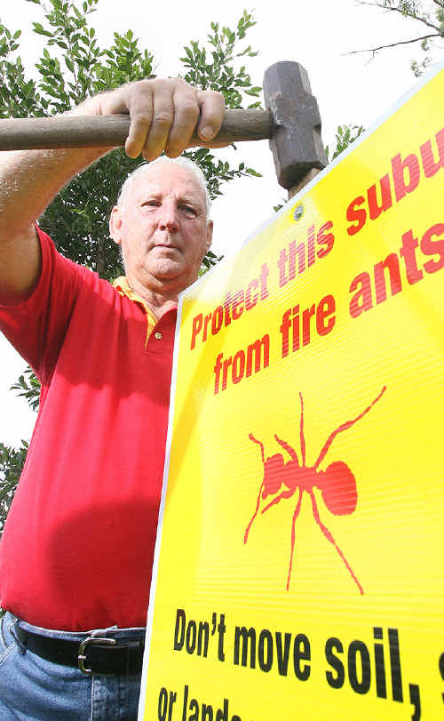 Evan Cordingley installs another fire ant sign in the Ipswich area.