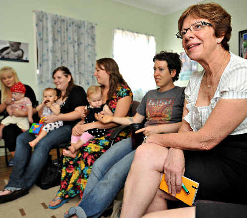 SUPER WOMAN: Clare Martin, right, with young mothers and mothers-to-be at Burnside Family Centre yesterday.