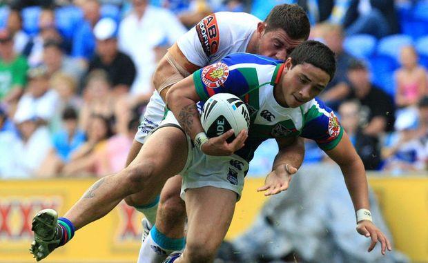 Mark Minichiello's tackle takes Warrior Kevin Locke off his feet.