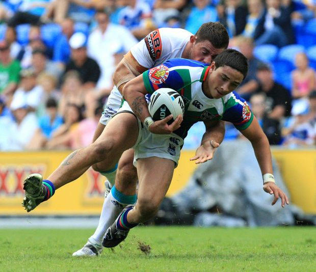 Mark Minichiello's tackle takes Warrior Kevin Locke off his feet.