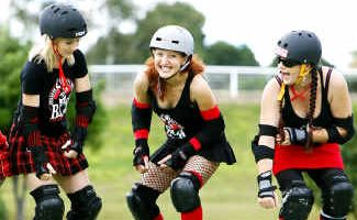 Tari Bowling 'Sweet Meat', Penny Glasswell 'Penergy', Nia Christy 'Alison Chainsaw' and Rachel Mackie 'Demolition Girl' prepare for upcoming roller derby bout.