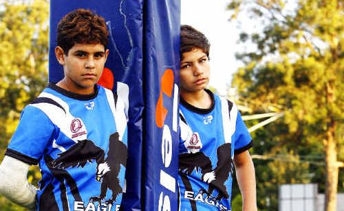 Young Goodna Eagles players Treymain Spry-Gagai (left), Treavon Drahm (right) and Nittest Kumar (seated) think their hero Israel Folau should stay with rugby league.