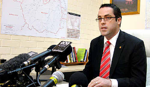 Aidan McLindon speaks to the media after resigning from the Liberal National Party along with Rob Messenger.