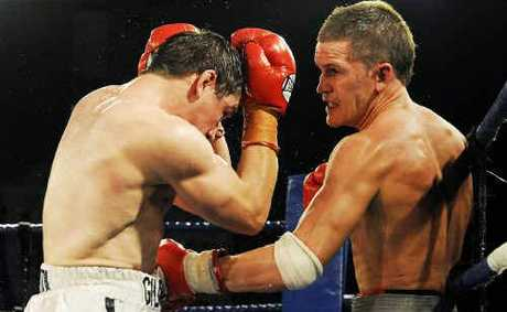 Jason Kanofski (right) produces a brave effort in the Australian welterweight title fight before losing on points to James Giltrow at Brisbane's Hilton Hotel on Saturday night.