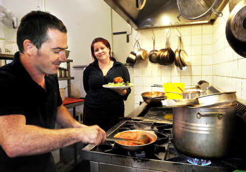 Cheesed-off: Stuart Campbell and Angelica Samut, owner-operators of Hummingbird Bistro at the Freemasons Hotel in Nimbin, busy in their kitchen.