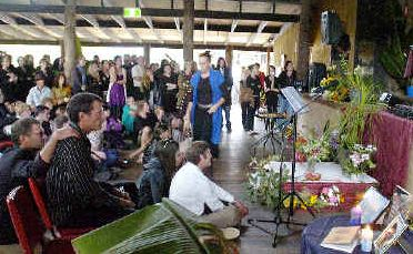 Communal grief: Friends and family gathered at the Billen Cliffs Hall to pay their last respects to Josef Hainaut and Michael O'Keeffe who lost their lives in an ultralight crash.