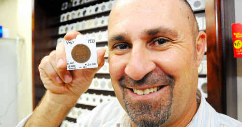 Coins & Collectables owner John Felesina is glad to see a rare coin like this 1930s Australian penny in Bundaberg.