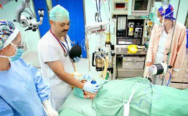 An anaesthetist prepares a patient for a ENT operation, Ipswich Hospital.