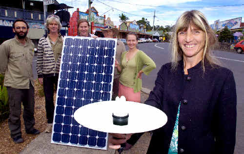 Nimbin is set to become Australia's most sustainable community with the installation of a solar farm. Nimbin Neighbourhood Centre's Natalie Meyer, one of the driving forces behind the project, is pictured with from left Paul O'Reilly, Adrian Winkler, and John Davis, from the Rainbow Power Company, Paul Le Bars and Lisa Lucken from the Nimbin Neighbourhood Information Centre.