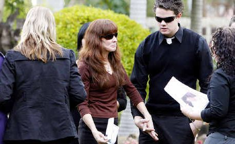 Justin Anderson's mother Donna Anderson (centre) is comforted by her son Jeremy (right) and friends after the funeral service at Goodna. Two doves were rel