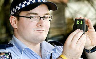 Constable Jarrad Bruce, of Toowoomba police, shows the cameras being trialled in the region.