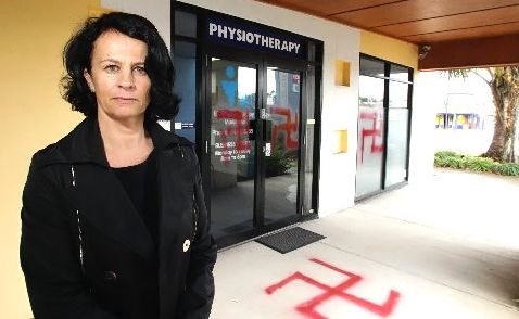 German-born Angela Kargoscha and her husband Dr Uwe Schwiersch are shocked after their shop front was spaypainted with swastikas.