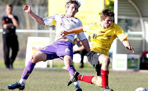 The Fire's Ryan Delahunty gets tackled from behind by the Capricorn Cougars' Fergus McIntosh.