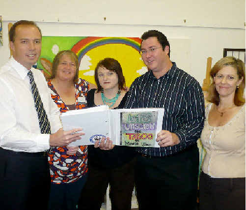 Shadow Health Minister Peter Dutton (left), chats to Mental Illness Fellowship clients Donna Bloedow and Tarah Bowman, LNP candidate George Christensen and mental health worker Sandi Winner.
