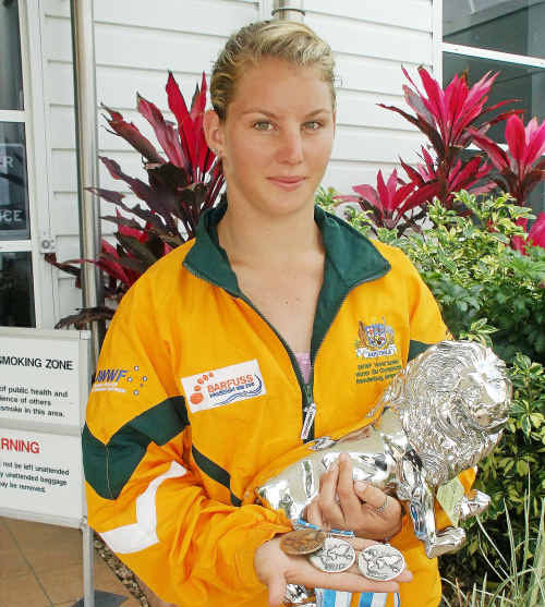 Ashleigh-Kate Stebbeings displays medals from the barefoot skiing world championships on her return to Mackay yesterday.