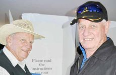 Bathurst 1000 winners John French and Dick Johnson in the polling booth at the Leyburn RSL during the Leyburn Sprints.