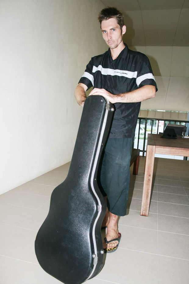 A frustrated Andrew Finlay has got the guitar, but it's not out of it's case.