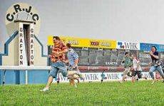 They're racing: Scott Kenny crosses the line ahead of his competitors in a race of a different kind at Grafton Racecourse.